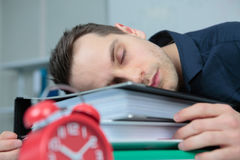 Pleasant man sleeping in office. Pleasant man sleeping in the office Stock Photography