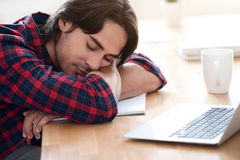 Pleasant man sleeping at the table Stock Photos
