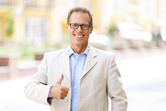 Pleasant man standing in the street Stock Photos