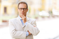 Pleasant man standing in the street Royalty Free Stock Image