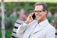 Pleasant man talking on phone Stock Photo