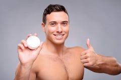Pleasant man using cream Royalty Free Stock Photos