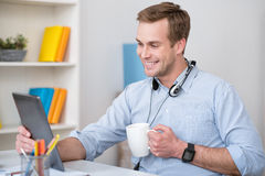 Pleasant man working in the office Royalty Free Stock Photography