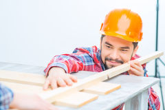 Pleasant man   working with wood Royalty Free Stock Images