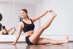 Pleasant masterful dancer doing an exercise stock images