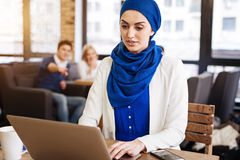 Pleasant muslim businesswoman feeling injustice from the society Stock Photos