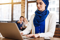 Pleasant muslim businesswoman working on the laptop Royalty Free Stock Image