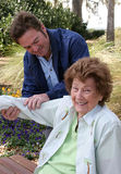 Pleasant Physical Therapy. A lovely senior woman enjoying her physical therapy in a garden setting Stock Photography