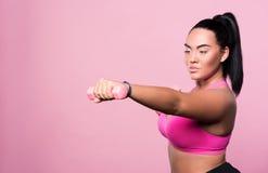 Pleasant plump woman doing sport exercises Stock Photos