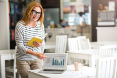 Pleasant positive woman working o the project royalty free stock photo