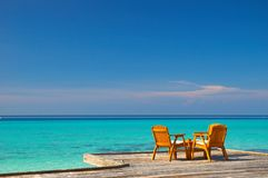 Pleasant seaview. Table and chairs with beautiful sea view Stock Photos