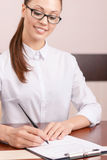 Pleasant secretary signing papers Royalty Free Stock Images
