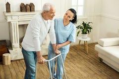 Pleasant senior man using walking equipment royalty free stock image