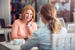 Pleasant senior woman conducting an interview Stock Photo
