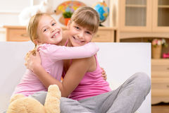 Pleasant sisters embracing Royalty Free Stock Images