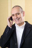 Pleasant and Smiling Man on Phone Stock Photos