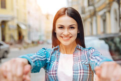 Pleasant smiling woman holding her boyfriends hands Royalty Free Stock Photos