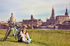 A pleasant stay on the grass after cycling Stock Photography