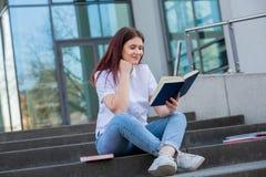 Pleasant student reading book stock image