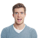Pleasant surprise. Young man looking pleasantly surprised with open mouth Stock Image