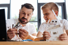 Pleasant teacher choosing a wire for the robot Stock Images