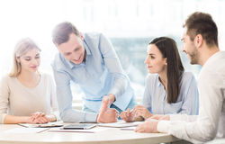 Pleasant team discussing a project Stock Images