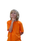 Pleasant Thoughts. Cute young boy wearing orange shirt in thoughtful pose Royalty Free Stock Photos