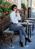 Pleasant time and leisure. Relax and coffee break. Happy to hear you. Woman attractive elegant brunette spend leisure royalty free stock photography