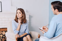 Pleasant tired woman talkign with psychologist Stock Photography