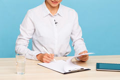 Pleasant TV announcer making notes Stock Photography