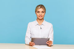 Pleasant TV announcer sitting at the table Royalty Free Stock Photo
