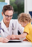 Pleasant visit at pediatrician's office Royalty Free Stock Photos
