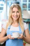 Pleasant waitress holding cup Stock Photography