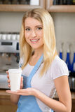Pleasant waitress standing at a counter Stock Photo