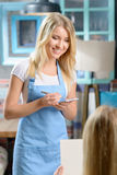 Pleasant waitress taking order Royalty Free Stock Photography