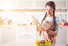 Pleasant woman cooking in the kitchen stock image