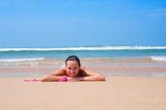 Pleasant woman lying on the sand Stock Photography