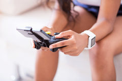 Pleasant woman playing video games Stock Images