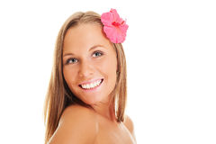 Pleasant woman with red flower Royalty Free Stock Image
