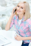 Pleasant woman sitting in the cafe Stock Photography