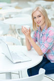 Pleasant woman sitting in the cafe Royalty Free Stock Photography