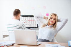 Pleasant woman sitting in the office Royalty Free Stock Photography