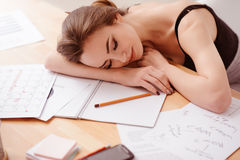 Pleasant woman sleeping at the table Stock Image