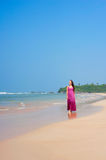 Pleasant woman walking at the beach Stock Images