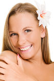 Pleasant woman with white flower Stock Image
