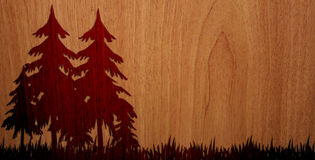 Pleasant Wood On Wood Background - Version 2. It's the illustration, on a wood background, of a pleasant wood, with trees and grass Royalty Free Stock Photography