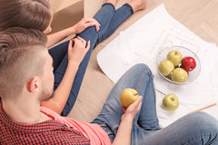 Pleasant young couple holding apples Stock Images