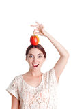 Pleasant young  girl apple Stock Photos