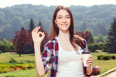 Pleasant young girl drinking coffee Royalty Free Stock Images