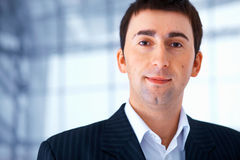 Pleasant Young Man. Portrait of a young pleasant man in black striped suit Stock Photography
